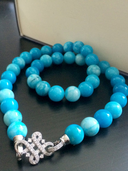 Classy blue jade necklace with beautiful crystal-encrusted locking mechanism, handmade with love in Canada, perfect for all occasions.