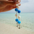 Beautifully handmade blue jade and pearls earrings with Sterling silver hooks, perfect to hit the beach in style or those hot summer nights.
