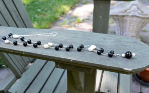 Handmade long pearls and agate necklace from Unik Gemz, made of irregular white pealrs and black agate stones.