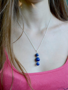 Delicate, handmade pendant made of lapis lazuli stones and a Sterling Silver plated chain. Another unique creation from Unik Gemz.