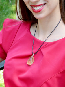 A beautifully handmade pendant made with a large lemon yellow quartz crystal, said to attract money and boost self-confidence.