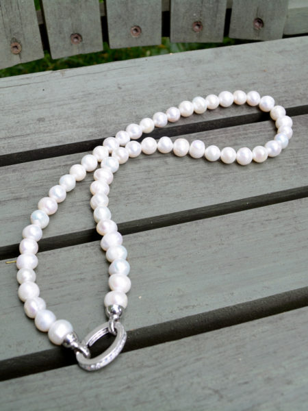 Magnificent and elegant handmade white pearls necklace, complimented with a classy crystal-encrusted clasp. Guaranteed to never go out of style!