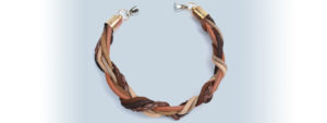 Bracelet for Men made from Entwined Leather Strips and Copper Endings.