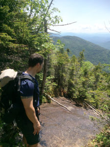 Pat stops to survey all the ground we've already covered climbing Mont Colden in the Adirondacks.